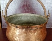 "Hammered copper pot, cauldron, or kettle with wrought iron swing handle and folded rim. ~11"" d x ~5"" tall. French?"