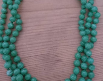 Vintage three strand green glass bead necklace