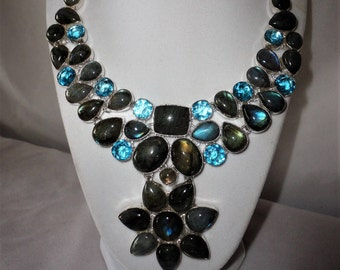 Fashionably Bold 680 Carats Labrodorite And Blue Topaz Silver Necklace Set****.