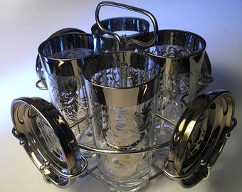 "Vintage Kimiko Guardian silver ""coat of arms"" caddy with four glasses and four coasters"