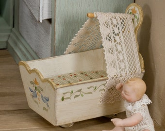 Toy cot, hand painted, dressed in cotton cloth and antique lace canopy.