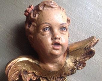 Little wooden angel's head