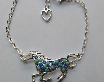 Blue horse pony equine charm on a Silver plated chain bracelet