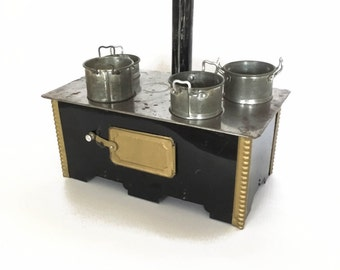 antique dollhouse stove with pots, pans and chimney
