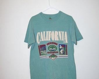1992 CALIFORNIA RUGGED OUTDOORWEAR green t-shirt size large
