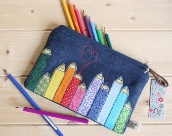 Pouch in jeans with free motion of colored pencils. Colorful pencil case