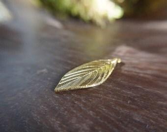 Antiqued gold leaf pendant