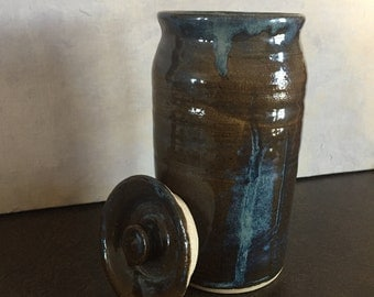 Ceramic lidded storage container, blues and browns 6 1/2 inches tall and 3 1/2 wide