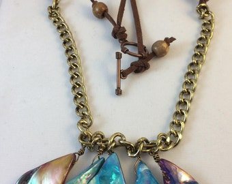 Unusual shell swade and gold necklace