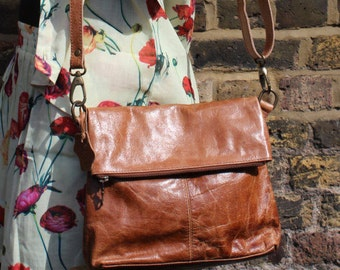 Amelie Tan Leather Foldover Messenger with Pockets front and back.