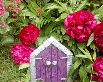 Large purple fairy door with a bottle of magical fairy dust, freestanding Gothic fairy door with silver bricks