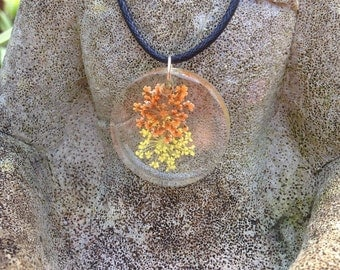 Dried flower resin necklace available in orange/cream.