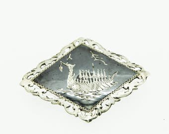A Niello Enamelled Silver Brooch Featuring A Longboat Design   SKU973