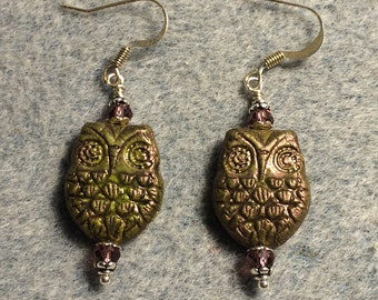 Green with purple wash Czech glass owl bead earrings adorned with purple Chinese crystal beads.
