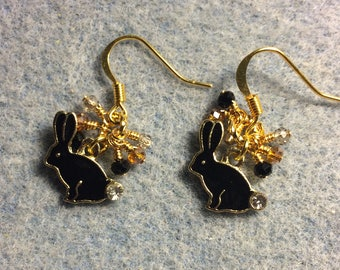 Small black enamel and rhinestone rabbit charm earrings adorned with tiny dangling black and amber Chinese crystal beads.