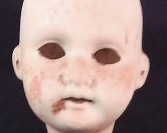 "antique german porcelain doll head,unpainted,Thuringia,excavated,1.9"" minimal damaged"
