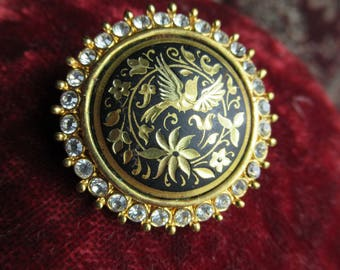 Gorgeous vintage small Damascene brooch with a crystal surround.