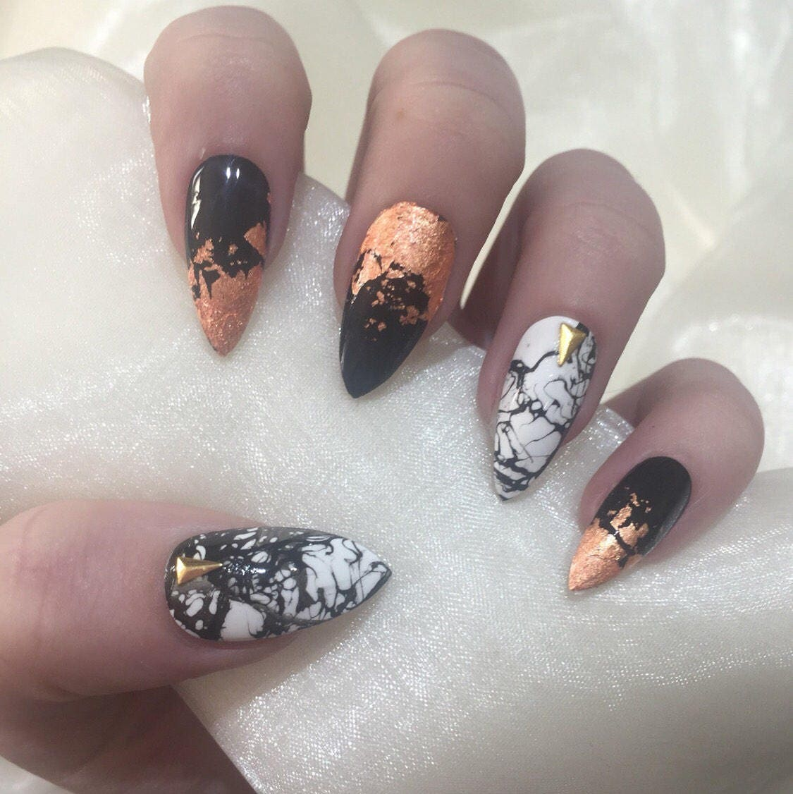 marble black and white stiletto false nails with rose gold
