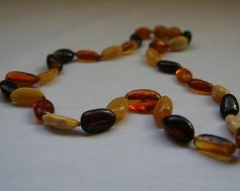 Multicoloured, genuine amber necklace.