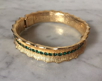 Vintage gold bangle with green gemstones. Rhinestone bracelet. 1960's bracelet. Vintage bangle. Gold bracelet. Costume jewelry. Green stone.