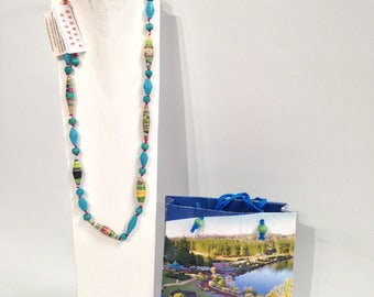 in the blue paper and glass necklace