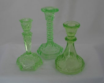 Set of three 1930s candlesticks in green uranium glass   - three candle holders by different European manufacturers
