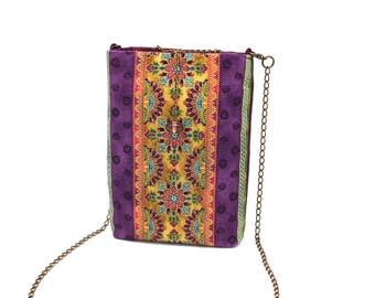 Violet smartphone bag patterned with pink and gold flowers