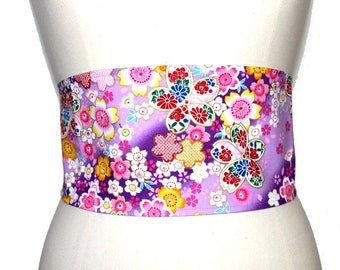 A violet belt patterned with cherry blossoms