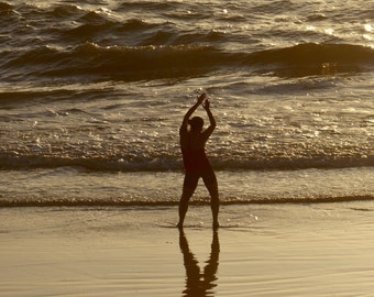 Dancing In The Sunset On The Beach