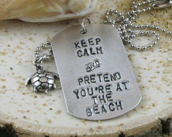 Keep calm and pretend you're at the beach. Hand stamped dog tag necklace.
