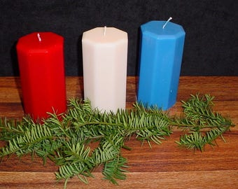 Set of 3 candles colors red, white and blue octagon pillar.