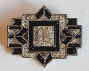 Silver tone Deco designed silver tone black enamel clear rhinestone pin brooch