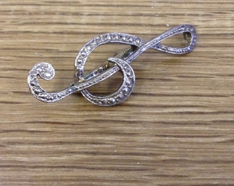 Vintage Silver Tone Marcasite Treble Clef Brooch / Lapel Pin In good condition this is a beautiful brooch.