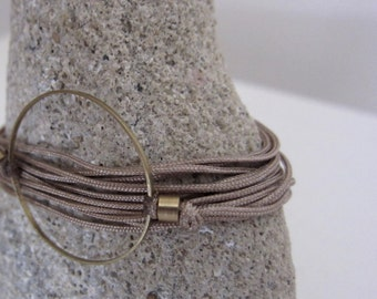 Minimal circle cord bracelet/geometry jewelry/waxed cord/adjustable necklace/adjustable bracelet/nude color cord/gift for her/bronze/gift
