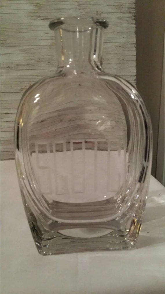 Scotch Whiskey Decanter. Embossed Scotch. Decanter is perfect.  Stopper has a couple chips. A great Holiday Gift.