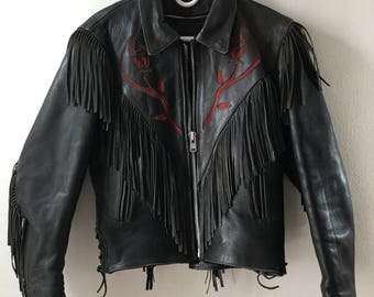 Black women's leather jacket, short jacket, real leather, motorcycle jacket, decorated with leather fringe, vintage style, size-extra small.
