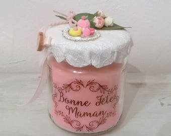 Candle celebrates mothers pink lace top, miniature cakes and flowers
