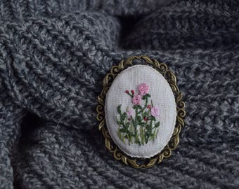 Brooch with embroidered meadow