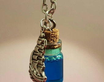Glass vials with ship charm on silver chain
