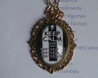 "chain and medallion of color gold with ""keep calm and beetlejuice"""