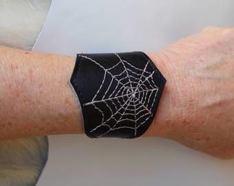 black leather wristband cuff spiderweb
