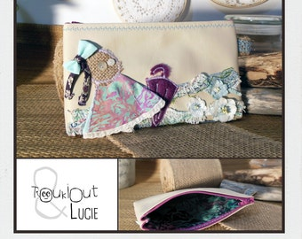 Embroidered spring pouch