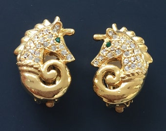 Adorable unique vintage seahorse clip on earrings .
