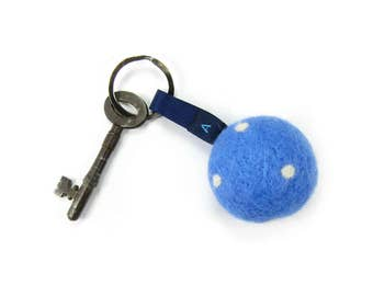 Soft handfelted wool ball keyring or handbag decoration in cornflower blue with white spots