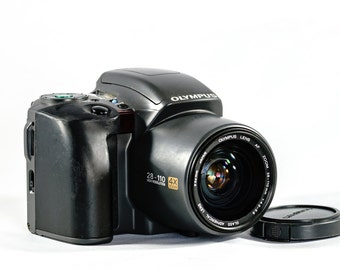 OLYMPUS IS-10 All-in-One Camera with 28mm - 110mm Aspherical Lens.