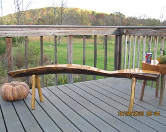 Rustic carved natural wood bench