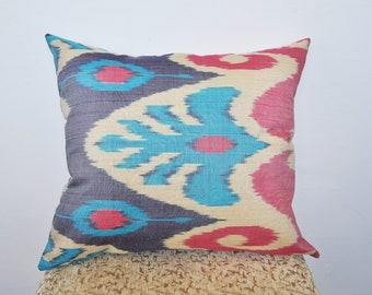 Rainbow ikat pillow red-orange-yellow shades. Red ikat pillows