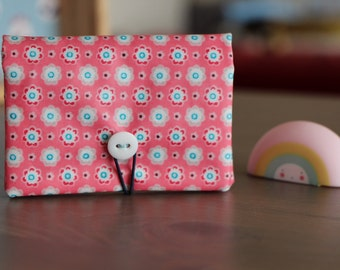 Card holder in pink coated fabric dotted with small flowers