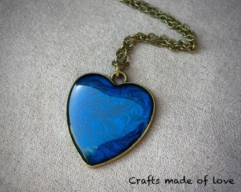 Blue heart shaped pendant