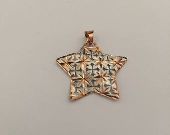 Star shaped pendant in white and rose 18k gold.